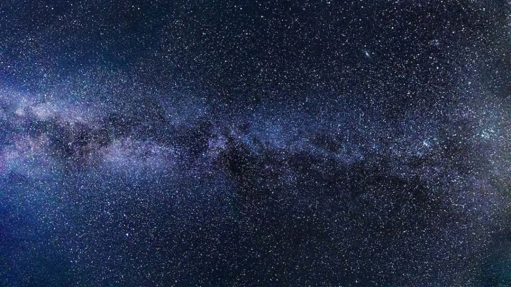 Photo of the night sky filled with stars and the Milky Way