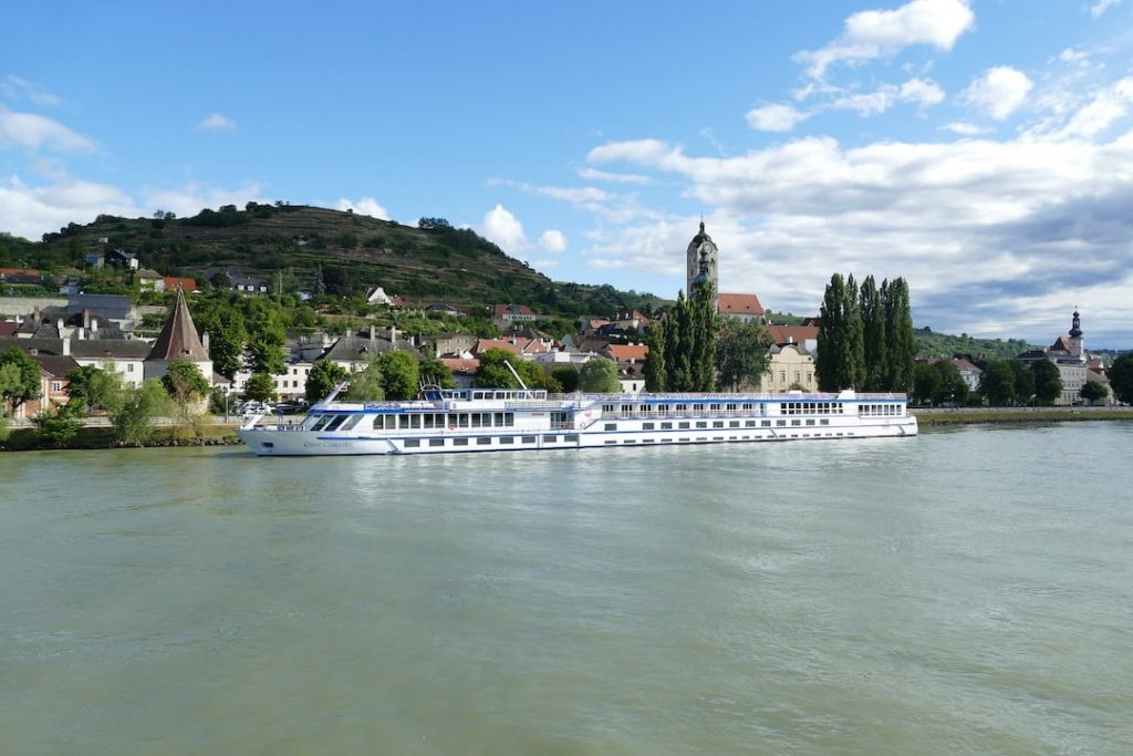 A river cruise ship docked in a city along the Danube