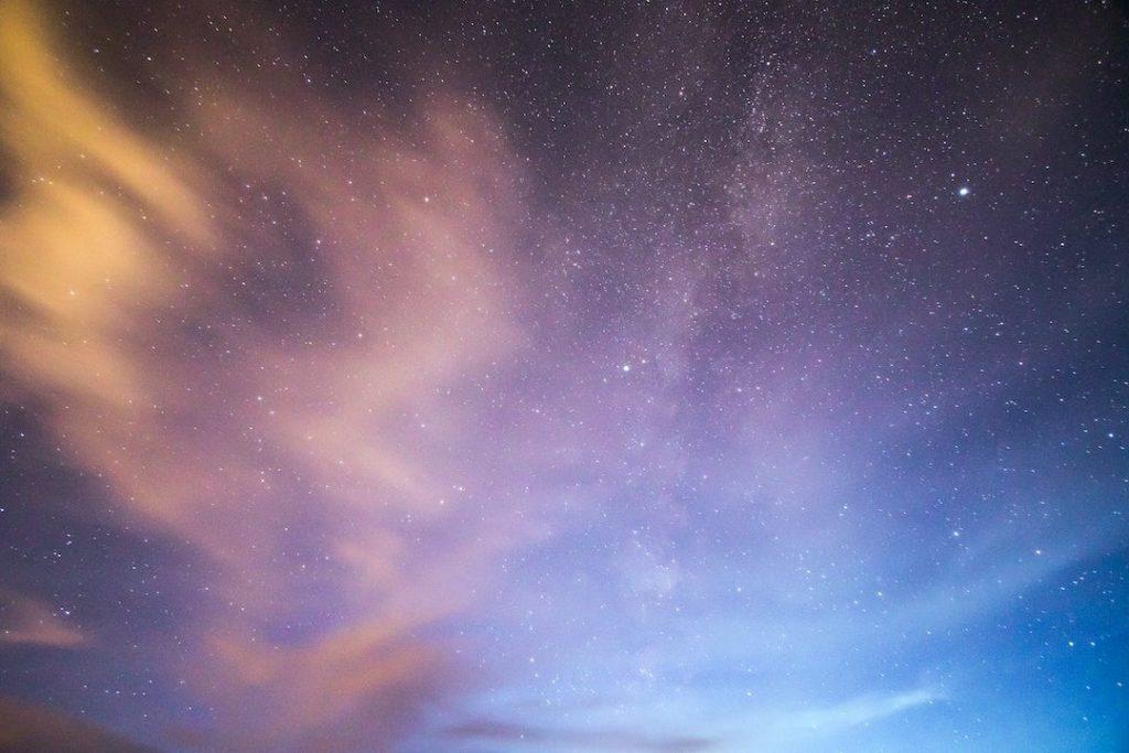 The starry night sky and nebula