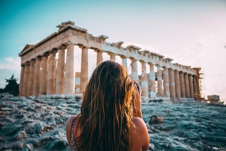 woman looking through at ruins