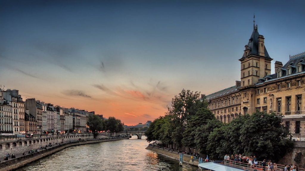 Buildings along the Seine River in Paris at sunset