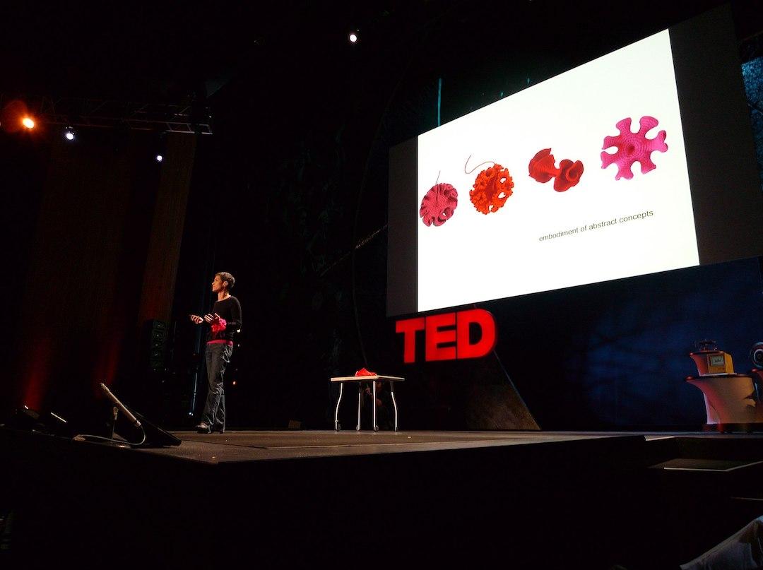 Margaret Wertheim on stage speaking at TED in 2009