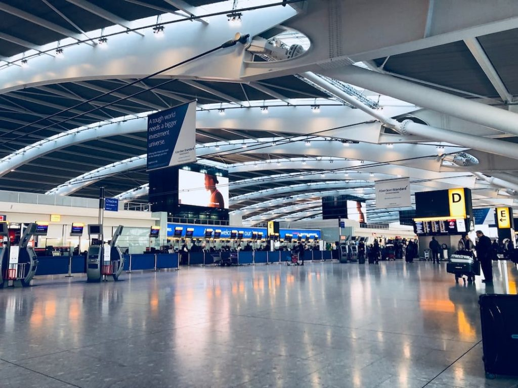 Check in counters and travellers in an airport