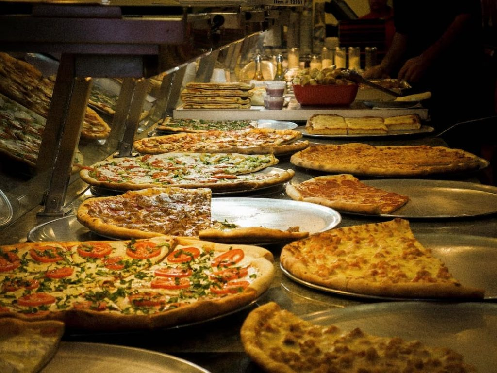 Different types of pizza ready to be served at a restaurant in New York City