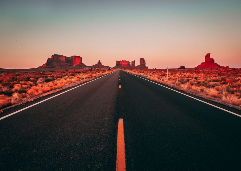 Empty road surrounded by desert in Utah