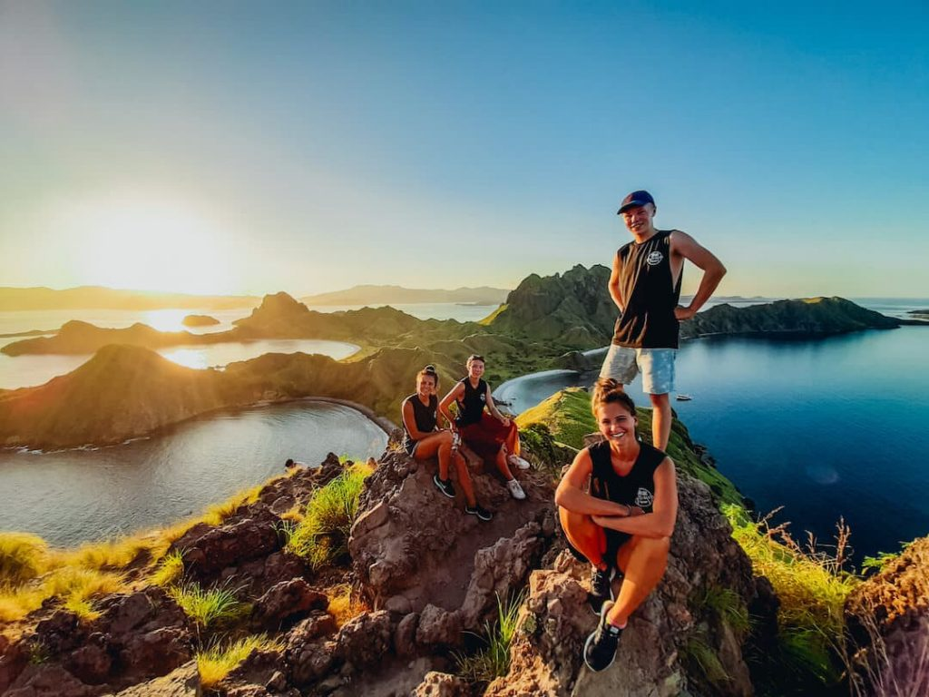 Group of travellers posing on a lookout point in Indonesia