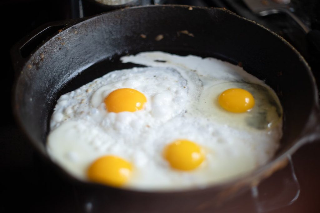 Four fried eggs in a skillet pan