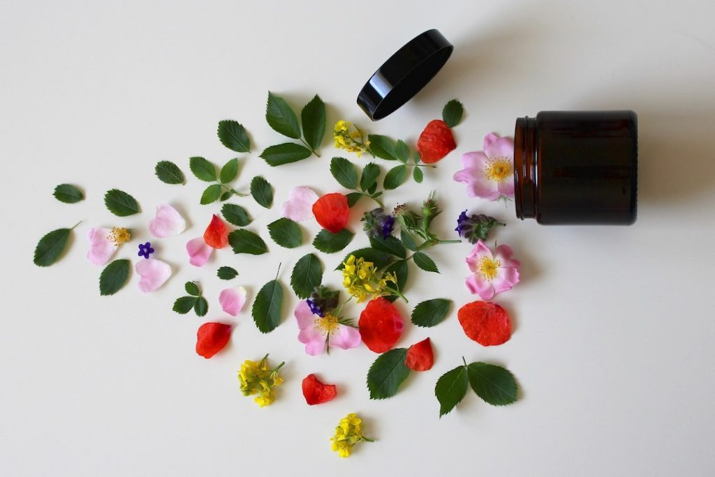 Cosmetic container with flowers and petals