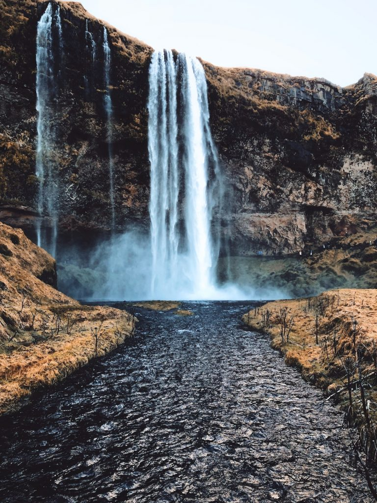 Waterfall flowing into a stream in Iceland