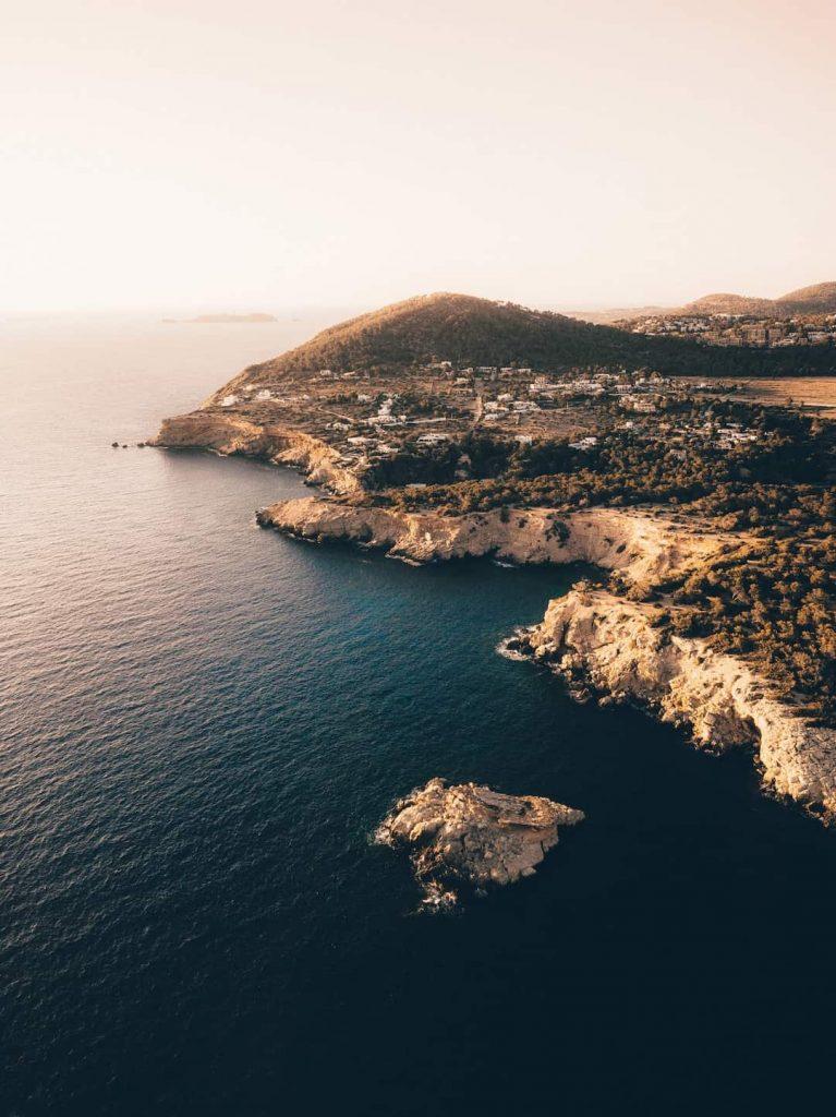 Coastline and pine-covered hills in Ibiza, Spain