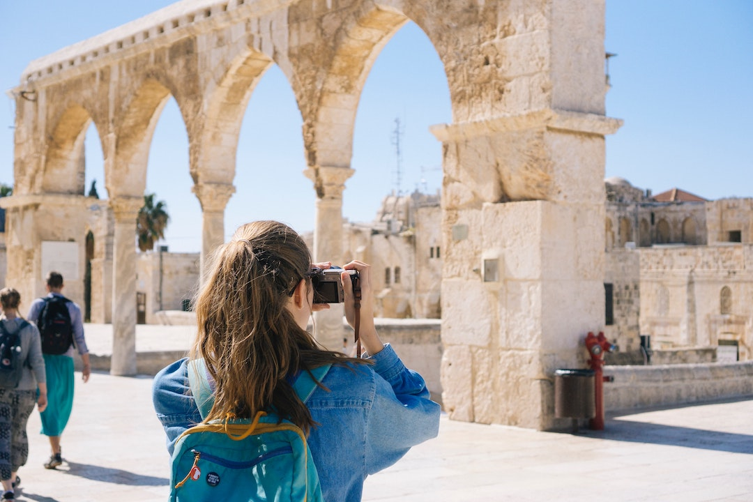 Woman taking a picture of ruins