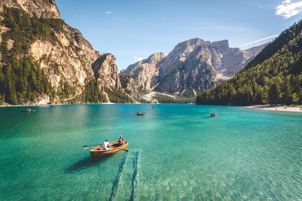 little boats sailing along a lake