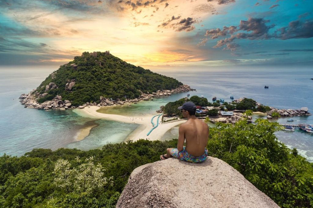 Person sitting at a lookout point on Koh Tao, Thailand