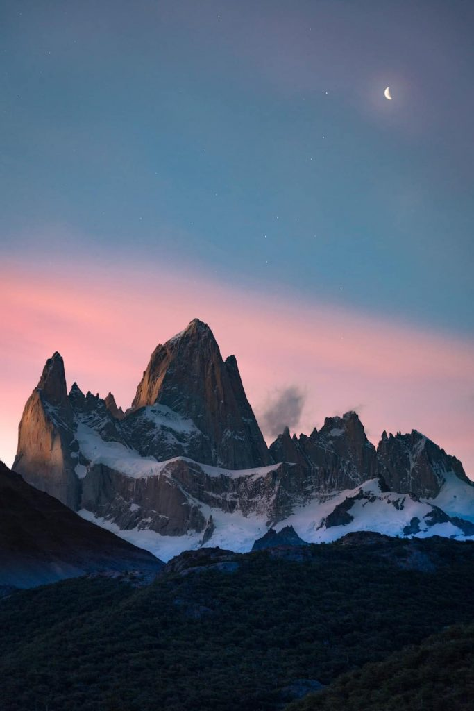 Mountain peak with moon in the sky at El Chaltén, Argentina