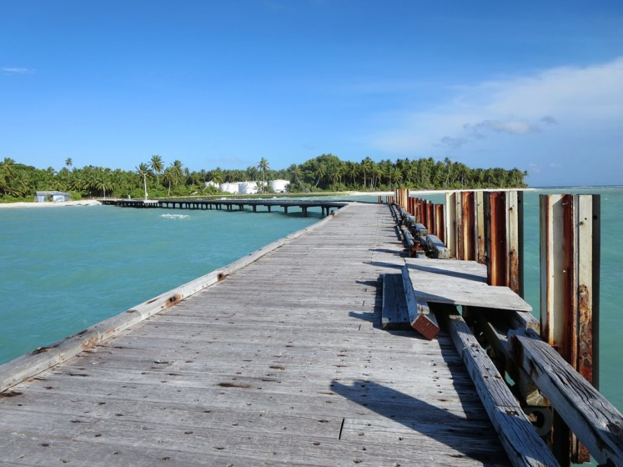Oil storage tanks adjoin the disused old jetty near the north end of West Island, Cocos (Keeling) Islands.