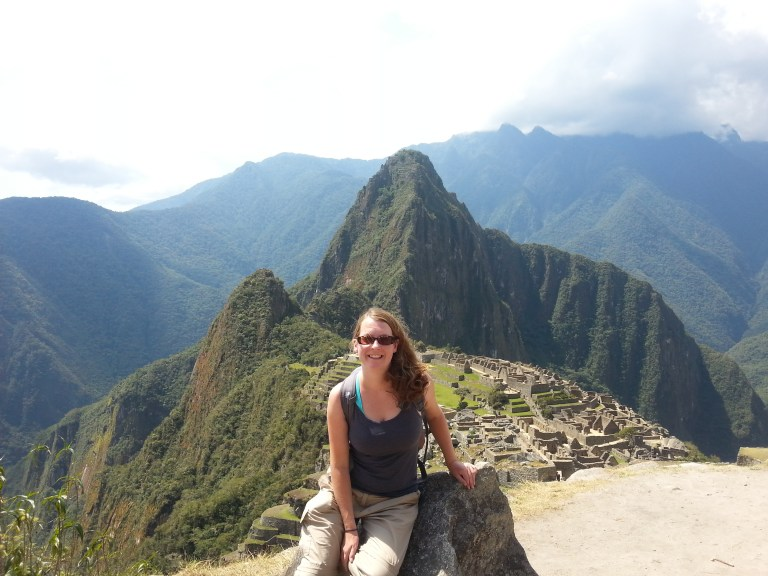 Claire , left smiling after reaching Machu Picchu